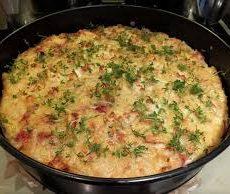 Eiertaart uit de oven  met rucola, pistachenoten en pecorino